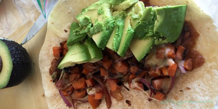 Sweet potato hash and avocado in a warm flour tortilla